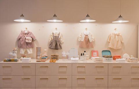 Room, Interior design, Display case, Ceramic, Furniture, Table, Shelf, Peach, Lighting accessory,