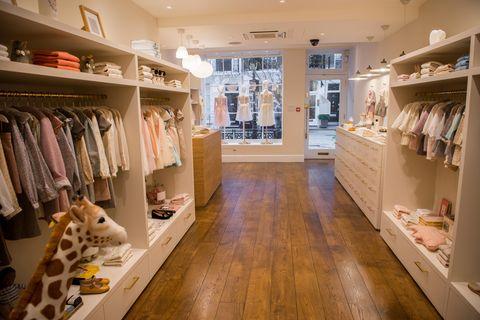 Room, Closet, Building, Boutique, Interior design, Floor, Footwear, Outlet store, Retail, Shelf,