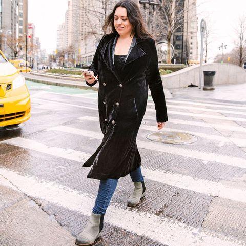 clothing, sleeve, human body, photograph, street, automotive lighting, outerwear, standing, headlamp, automotive parking light,