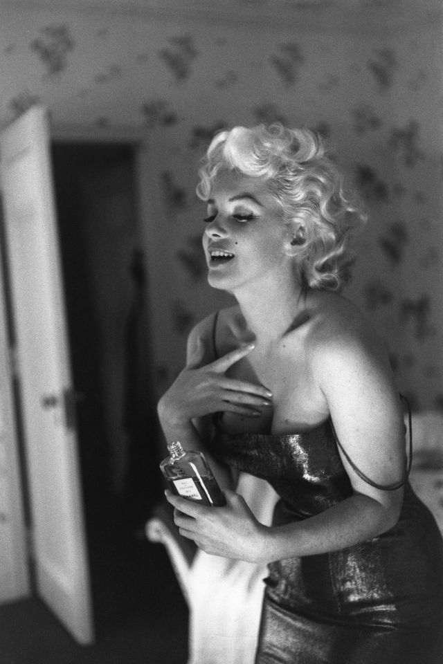 """new york   march 24 actress marilyn monroe gets ready to go see the play """"cat on a hot tin roof"""" playfully applying her make up and chanel no 5 perfume on march 24, 1955 at the ambassador hotel in new york city, new york photo by ed feingershmichael ochs archivesgetty images"""