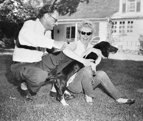 Marilyn Monroe and Arthur Miller Sitting on Lawn with Dog