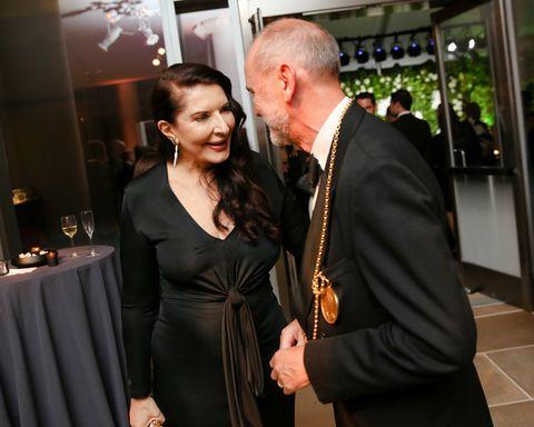 Event, Fashion, Suit, Formal wear, Little black dress, Fun, Dress, Tuxedo, Smile, White-collar worker,