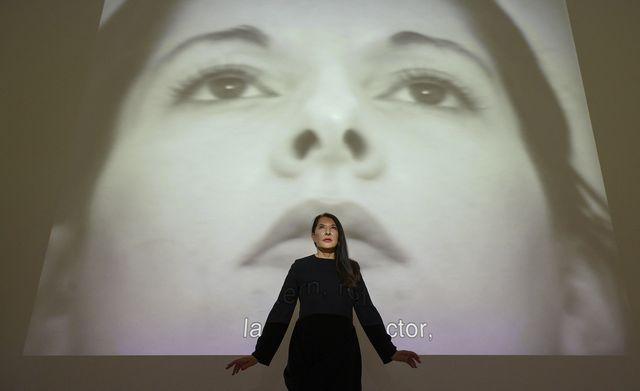 """serbian performance artist marina abramovic poses in front of an installation explaining her own life in her exhibition """"jenes selbst  unser selbst"""" that self  our self at the kunsthalle in tuebingen, southern germany, on july 23, 2021   the exhibition last from july 24, 2021 until february 13, 2022   restricted to editorial use   mandatory mention of the artist upon publication   to illustrate the event as specified in the caption photo by thomas kienzle  afp  restricted to editorial use   mandatory mention of the artist upon publication   to illustrate the event as specified in the caption  restricted to editorial use   mandatory mention of the artist upon publication   to illustrate the event as specified in the caption photo by thomas kienzleafp via getty images"""