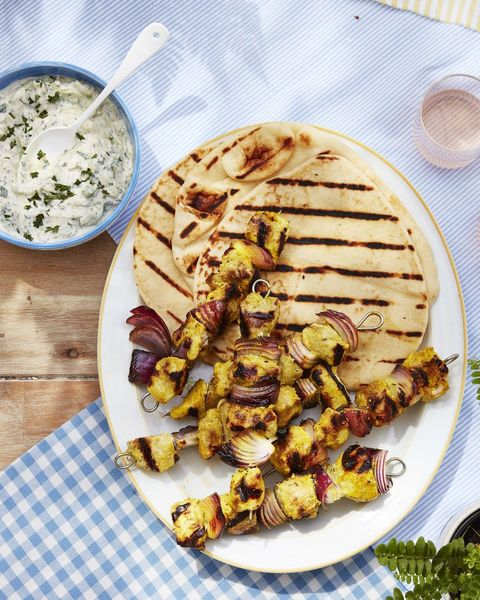 indian spiced marinaded chicken kebabs with red onion and yogurt dipping sauce