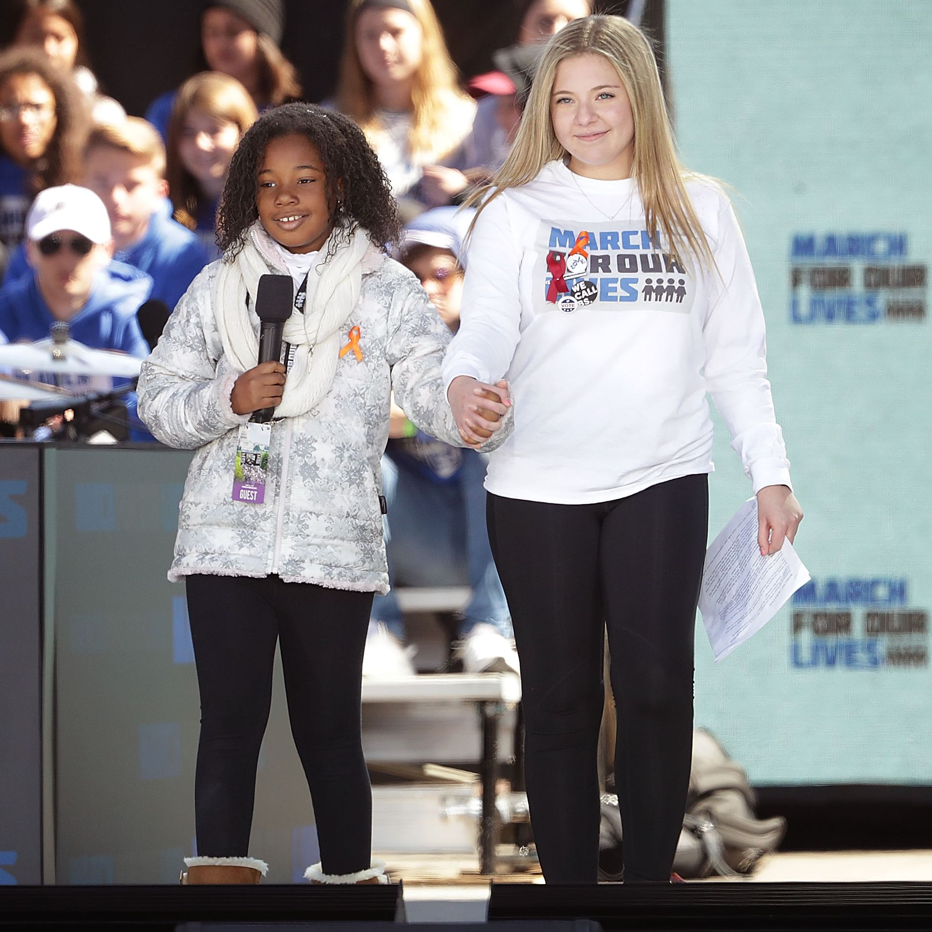 Martin Luther King Jr.'s granddaughter, Yolanda Renee King (left), joins Jaclyn Corin (right) on stage at the March for Our Lives in Washington, D.C.