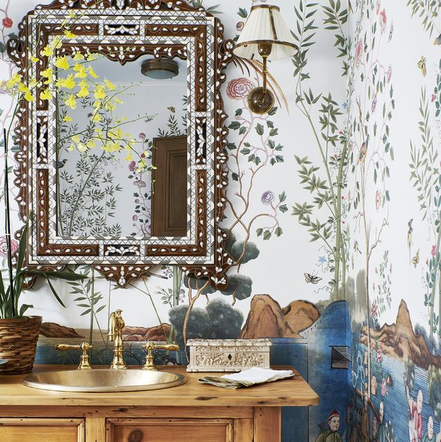 hand painted wallpaper iksel forms a florid backdrop for a bone inlay mirror charles jacobsen in the powder room