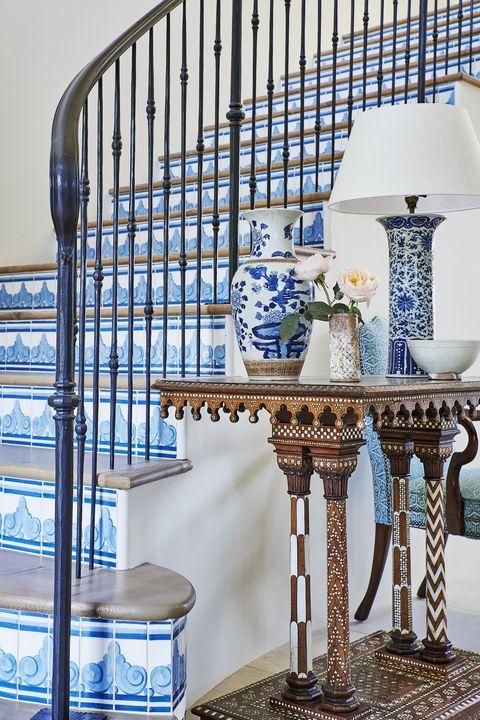 hand painted tiles ns ceramic climb the entry stairs alongside an italian moorish table