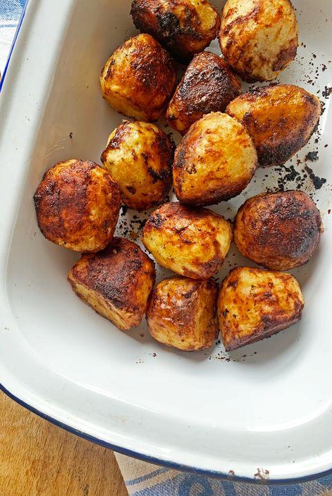 roast potatoes in a white roasting tin