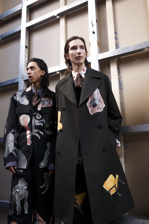 Fashion, Trench coat, Overcoat, Costume, Street fashion, Uniform, Outerwear, Coat, Suit, Formal wear,