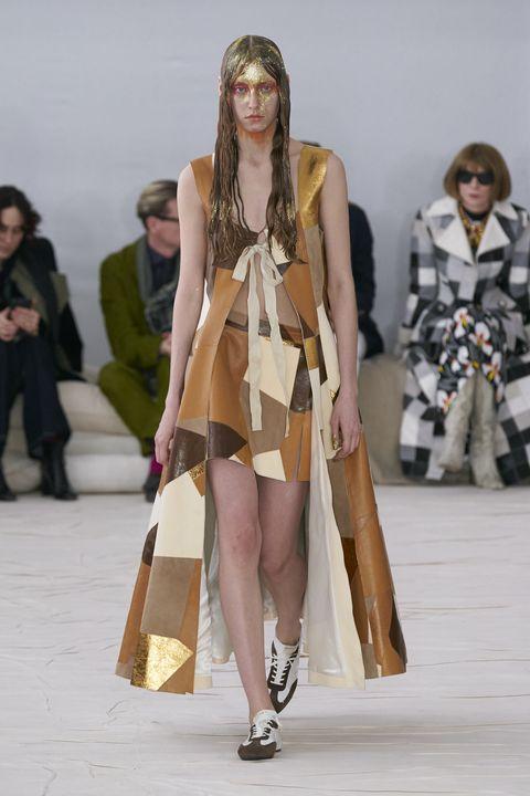 Footwear, Leg, Brown, Human leg, Outerwear, Style, Costume design, Fashion show, Bag, Fashion model,