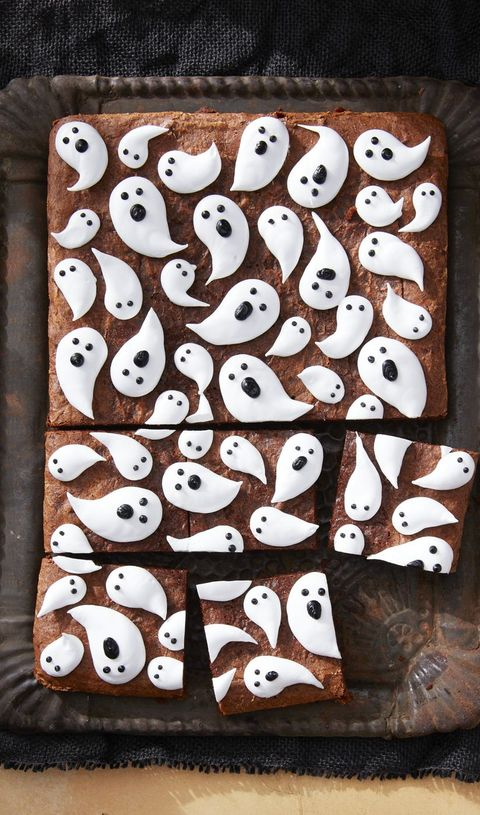 a tray of brownies with marshmallow ghosts all over