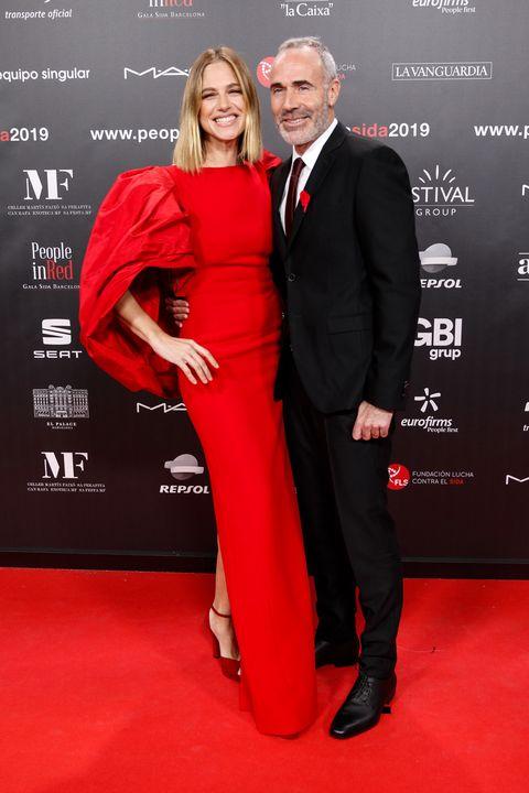 Red carpet, Carpet, Red, Suit, Premiere, Formal wear, Tuxedo, Event, Flooring, Dress,
