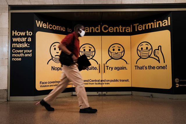 new york city   july 27 a person wears a mask while walking in grand central terminal on july 27, 2021 in new york city due to the rapidly spreading delta variant, the centers for disease control and prevention cdc has recommendedthat fully vaccinated people begin wearing masks indoors again in places with high covid 19 transmission rates  photo by spencer plattgetty images photo by spencer plattgetty images