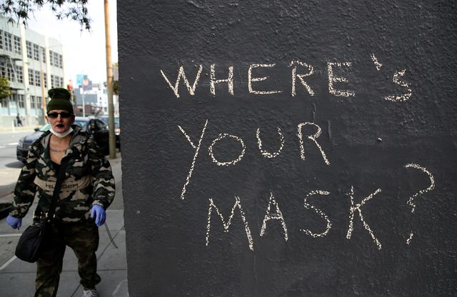 san francisco, california    april 20 a pedestrian walks by graffiti encouraging the wearing of masks on april 20, 2020 in san francisco, california counties in the san francisco bay area have announced that people must wear masks when in public or at the workplace in an effort to slow the spread of coronavirus covid 19 photo by justin sullivangetty images