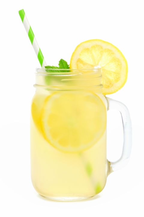 Mason jar of lemonade with straw isolated on white