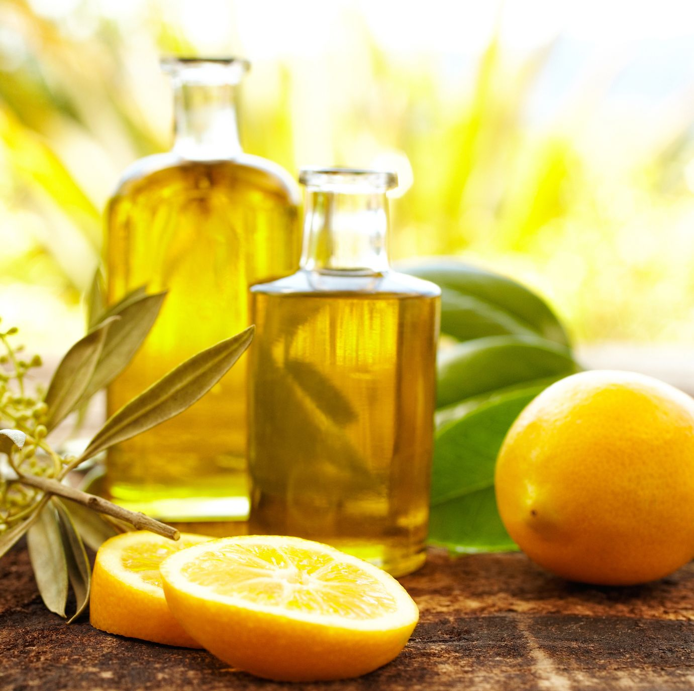 Massage oil bottles with lemons and olive branch