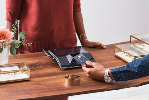 Desk, Furniture, Table, Sitting, Hand, Fashion accessory, Interior design, Tableware,