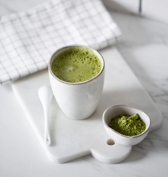 matcha green tea latte in a rustic cup