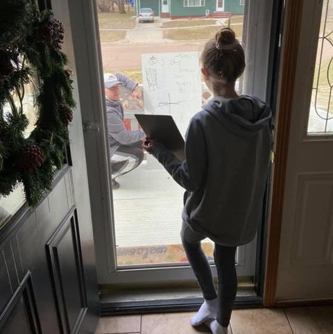 math-teacher-helps-student-from-her-front-porch