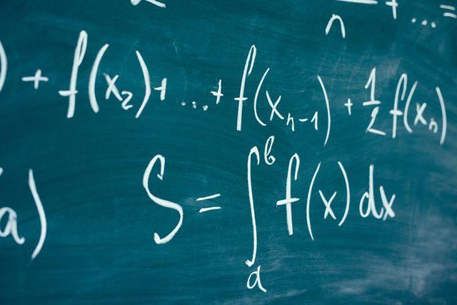mathematics function integra formulas written by chalk on the chalkboard