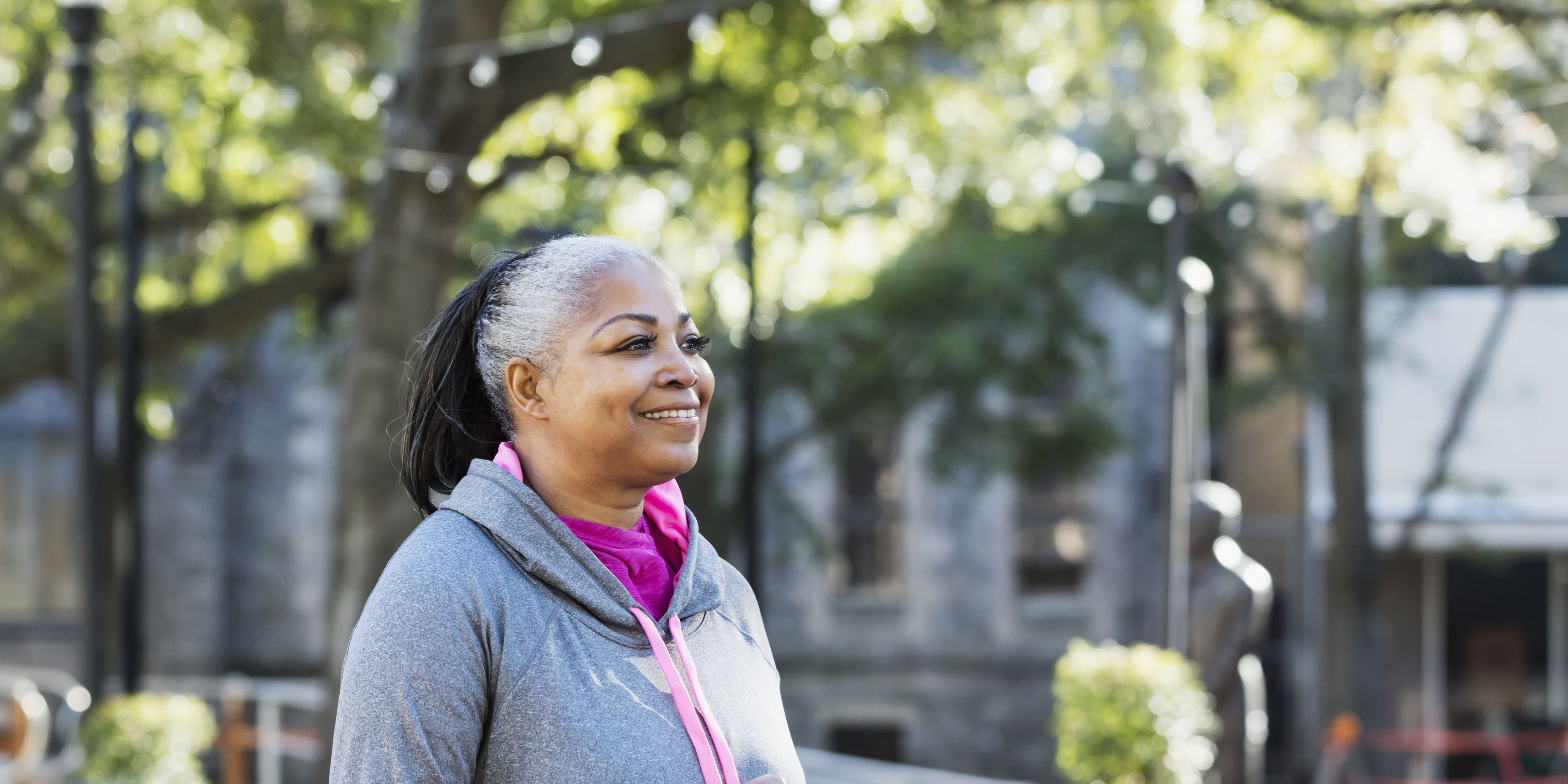 Mature African-American woman jogging in city