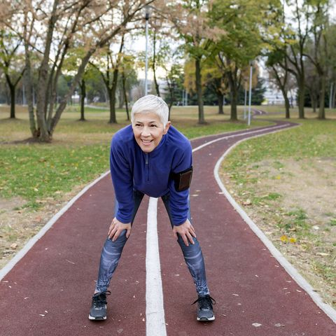 Mature Athlete Woman Taking a Break After Jogging