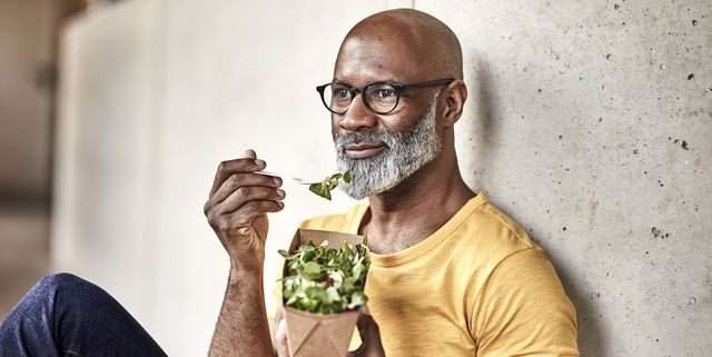 mature businessman having lunch break eating a salad