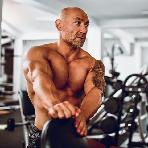 Mature Male Bodybuilder Stretching