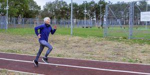 Mature Sporty Woman Jogging in Public Park
