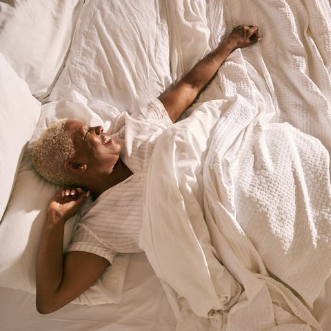 mature woman in bed morning