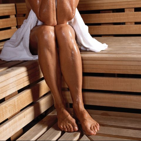 Mature woman in sauna, low section
