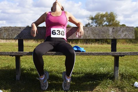 mature woman resting after competitive runningrace