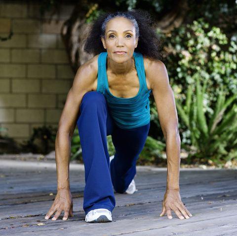 Mature woman stretching
