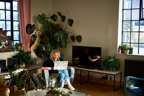 Mature woman using laptop in living room