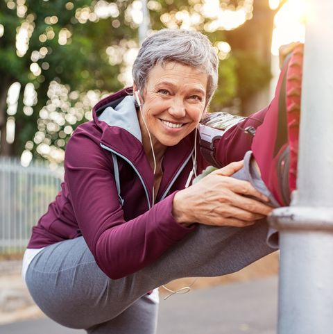 mature woman warming up before jogging