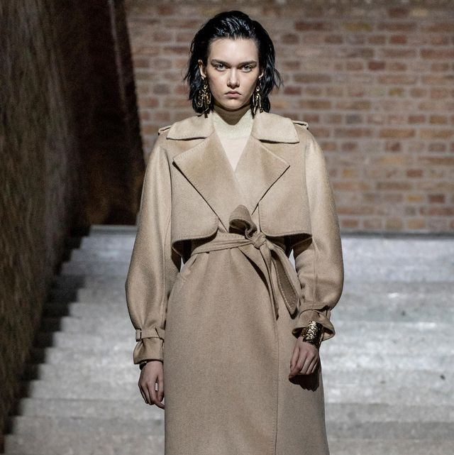 Fashion model, Clothing, Fashion, Coat, Trench coat, Overcoat, Fashion show, Outerwear, Street fashion, Human,