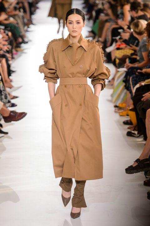 Fashion model, Fashion, Fashion show, Runway, Clothing, Coat, Beige, Haute couture, Fashion design, Outerwear,