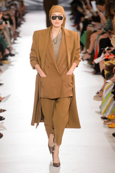 Fashion show, Fashion model, Fashion, Runway, Clothing, Outerwear, Eyewear, Coat, Public event, Human,