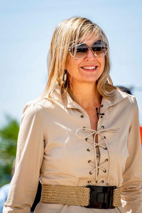 máxima wind zonnebril beige jurk