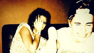 "Justin and Selena take a trip to Los Cabos, and Justin shares a photo on Instagram with the caption, ""2 much fun."""