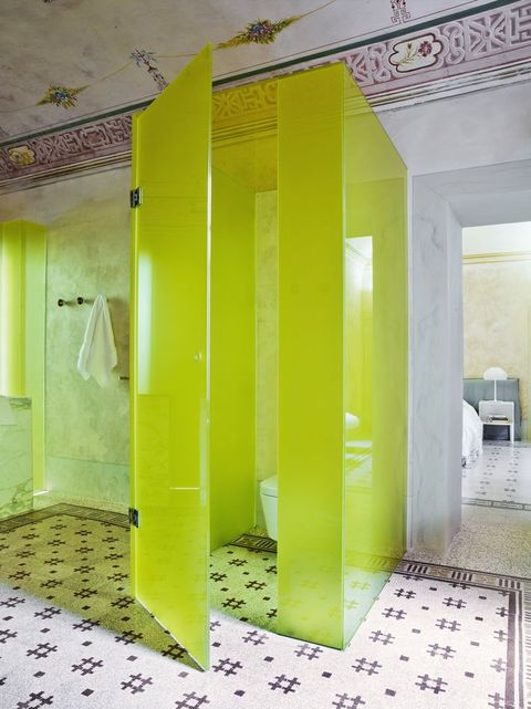 traditional italian bathroom with neon yellow glass cubicle