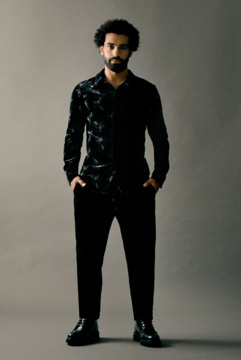 Clothing, Fashion model, Standing, Fashion, Suit, Formal wear, Outerwear, Human, Sleeve, Neck,