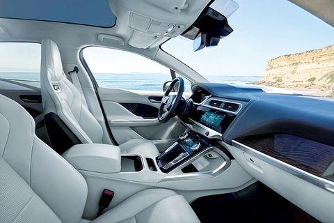 Land vehicle, Vehicle, Car, Personal luxury car, Luxury vehicle, Center console, Automotive design, Executive car, Mid-size car, Steering wheel,