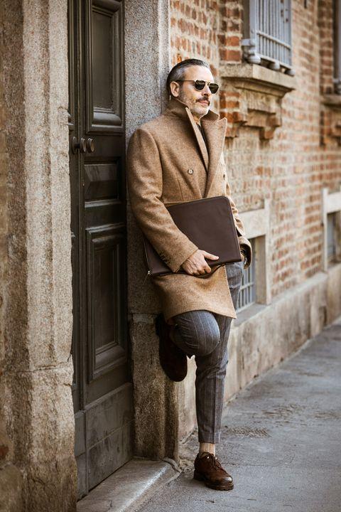 Trousers, Window, Outerwear, Standing, Coat, Street fashion, Collar, Knee, Door, Brick,