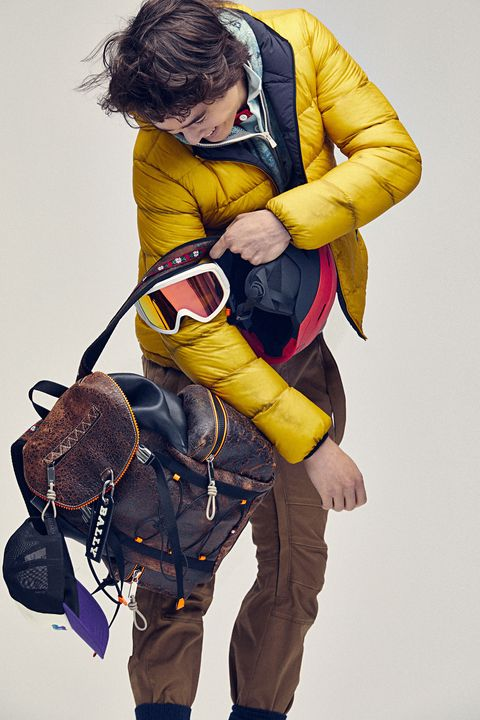 Yellow, Personal protective equipment, Outerwear, Climbing harness, Lifejacket, Backpack, Adventure,