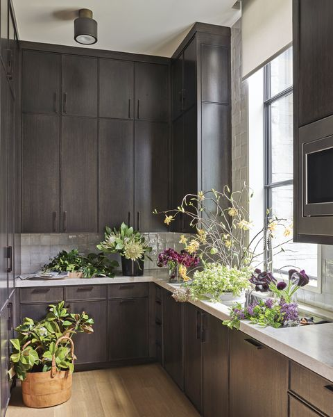 ebonized cabinetry and bronze hardware continue  in the back kitchen