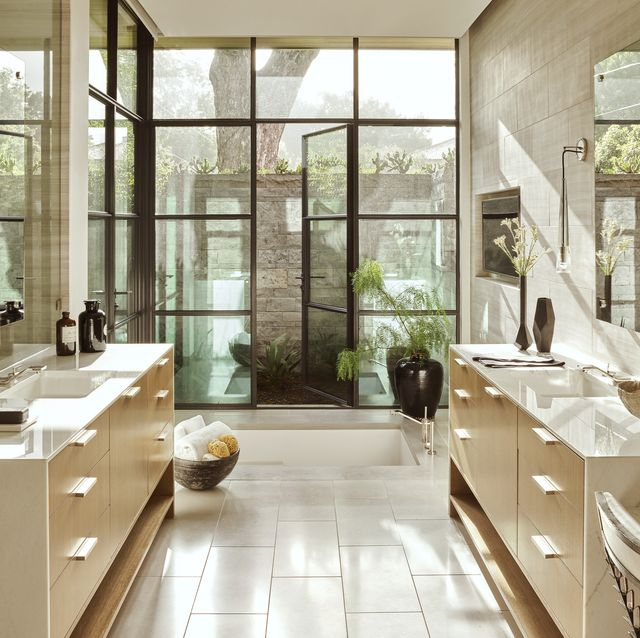a sunken tub and walled shower garden in the owners' bath