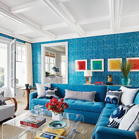 Blue family room with white curtains