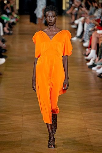 Fashion model, Fashion show, Runway, Fashion, Orange, Clothing, Shoulder, Footwear, Yellow, Joint,