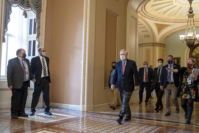 washington, dc   november 30 senate majority leader mitch mcconnell r ky walks back to his office after opening up the senate on capitol hill on november 30, 2020 in washington, dc sen mcconnell temporarily suspended in person lunches for the gop caucus after several senators tested positive for coronavirus covid 19 in the past few weeks photo by tasos katopodisgetty images